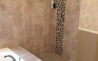 Custom stone tile shower with inlay