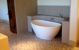 Stone & tile bath floor & tub surround