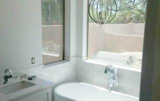 Modern white tiled bathroom and tub