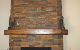 Custom Stone Fireplace and solid wood mantle