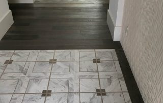 Decorative Tile Entry Leads into Hardwood Flooring