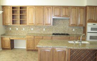 Travertine Tiles, Granite Tops and Wood