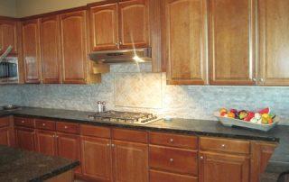Custom Backsplash, Travertine tiles, Dark Counter tops