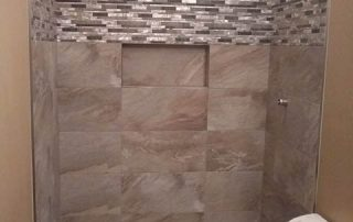 Porcelain Tile Stacked with Deco Band and Horizontal Niche shower
