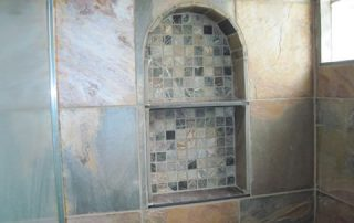 Stone tiled shower niche