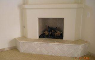 Travertine tile fireplace - Travertine baseboards - Frieze carpet