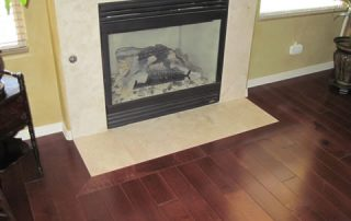 Wood Floor and Travertine Fireplace