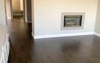 Wood floors, baseboards and fireplace surround