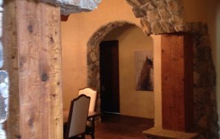 Wood floor and stone arch